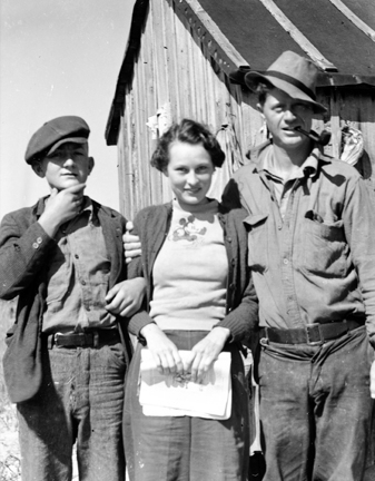 Elizabeth Turner (later Taylor) posing with Leonard Gillikin on the right and a young fisherman on the left, Brown's Island, N.C. Ms. Taylor thought the boy was mostly likely Moses Gillikin.