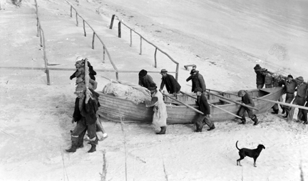 Mullet Fishermen carrying boat onto beach, Brown's Island, N.C.