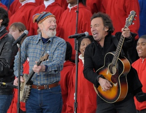 "Pete Seeger and Bruce Springsteen leading a crowd at Pres. Obama's inauguration in a rollicking version of Woody Guthrie's ""This Land is Your Land."""
