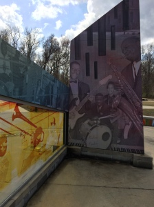 """Intersections,"" by David Wilson and Brandon Yow, uses old photographs, vintage maps & original artwork (some of it in the style of African American artist Romare Bearden of Charlotte) to honor Kinston's African American musical communities."