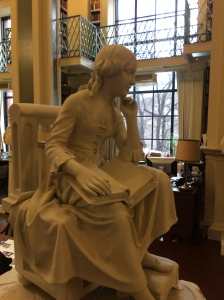 "Robert Ball Hughes' ""Little Nell,"" ca. 1851, a plaster sculpture depicting the popular character from Charles Dickens' novel The Old Curiosity Shop, sits outside the Vershbow Special Collections Reading Room at the Boston Athenaeum."