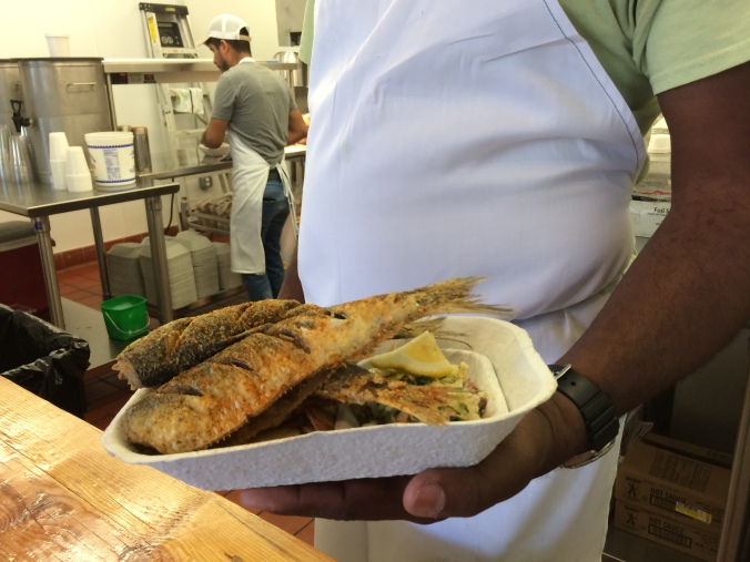 Ricky Moore serving up fresh fried herring and his special homemade slaw at his Salt Box Seafood Joint in Durham, N.C. The celebrated chef comes from my home county on the N.C. coast, and we're all mighty proud of him! Photo by David Cecelski