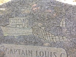 "Detail from the grave marker of Capt. Louis C. Styron. Below his name and date of death, the marker reads: ""Helmsman of the Sea, Beloved Pilot of our Lives"""