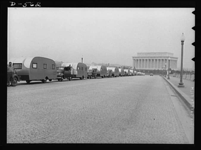 """n """"emergency caravan"""" of mobile homes crosses Memorial Bridge in Washington, DC, bound for defense workers in Wilmington, N.C. (April 1941). Courtesy, Library of Congress Prints and Photographs Division, Washington, DC"""