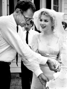 Arthur Miller and Marilyn Monroe cut the cake at their wedding in 1956. From the TV-Radio Mirror (May 1961)