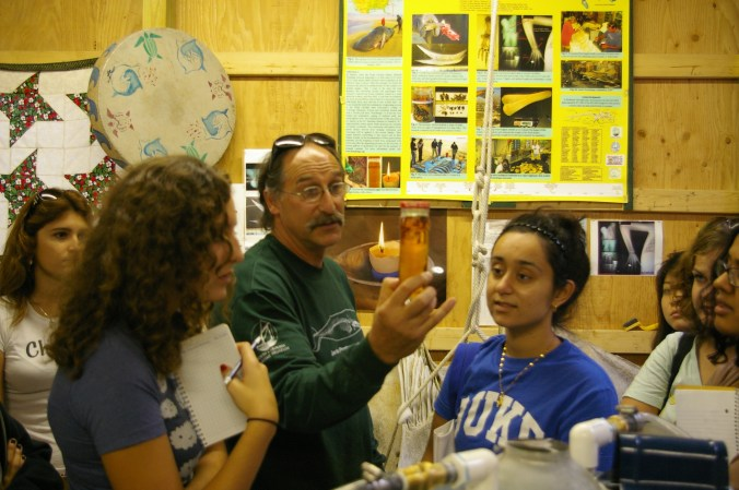 Keith Rittmaster displaying spermaceti oil to students at Bonehedge, a laboratory originally created for rearticulating a sperm whale skeleton. Courtesy, Andrew David Thaler and his fascinating Southern Fried Science blog on ocean science and conservation.
