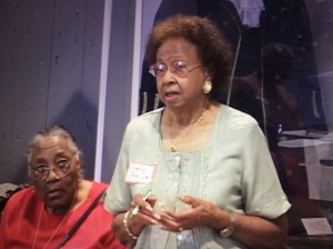 Ms. Francis Jones-Isler, age 88, telling stories at the Lake Waccamaw Depot Museum. To her right is another panelist, Ms. Ida Young, age 80 at the time. Courtesy, the Lake Waccamaw Depot Museum.
