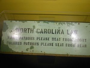 A bus segregation sign from North Carolina. The state's legislature was still passing new Jim Crow laws in the 1950s, including one that banned interracial swimming pools.