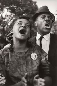 "Jacquelyn Bond and Golden Frinks singing ""We Shall Overcome"" at the March on Washington in 1963. Courtesy, National Museum of African American History"