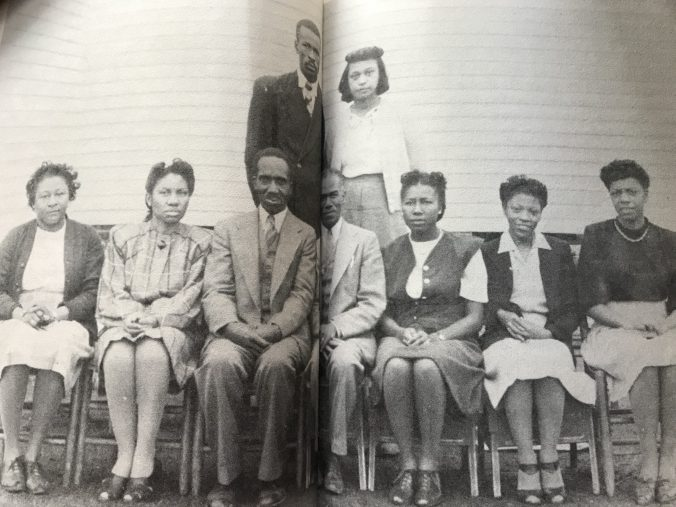 Hyde County Training School faculty, probably 1950s. Left to right, Senia Sheperd Johnson, Annie Bonner, John Raleigh Spencer, O. A. Peay, Rosa Mackey Bell, Beulah Kelsey McNair, Lucie B. Hargraves. Standing: Seward Selby, Rosaliner Hill. From Selby et.all, Hyde County History