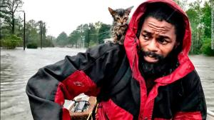 "Robert Simmons Jr. and ""Survivor,"" New Bern, Sept. 14, an already famous photograph by Andrew Carter at the Raleigh News & Observer"