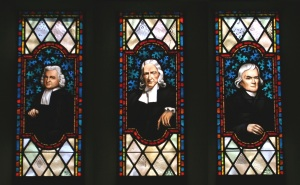 Stained glass windows depicting (left to right) Charles Wesley, John Wesley and Francis Asbury, all central figures in the establishment of Methodism. Memorial Chapel, Lake Junaluska, N.C.