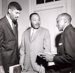 Dr. King spoke in support of a voter registration drive at Goler Metropolitan AME Zion Church in Winston-Salem, N.C., on April 13, 1964. He is standing with local civil rights leaders Kenneth Williams III and Clarence Montgomery. Courtesy, the Winston-Salem Journal