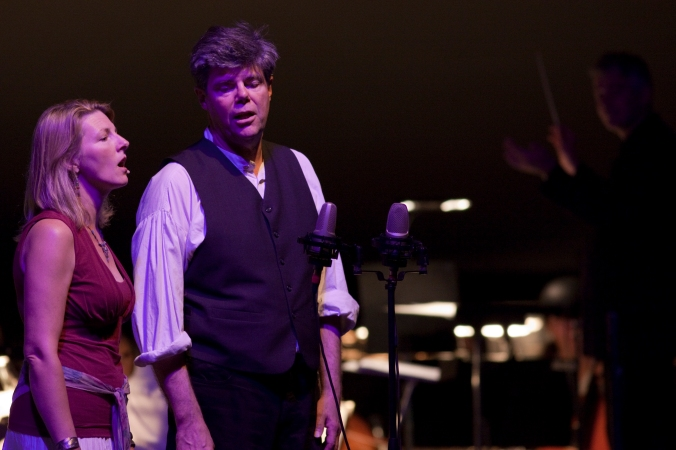 "Jeff Warner performing a lovely version of ""Her Bright Smile Haunts Me Still"" with Laurelyn Dossett and the NC Symphony in 2009. You can hear the performance here. Jeff's parents learned the song from Eleazar and Tink Tillett and Martha Etheridge in Wanchese, N.C. Jeff and his brother Gerret's <a href=""http://mountains2thesea.com"">From the Mountains to the Seas</a> show will be touring NC later this year and next. Courtesy, Gerret and Jeff Warner"