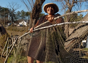 Historian and folklorist Alice Eley Jones displaying some of her father's bow nets when I interviewed her at her family's home in Murfreesboro, N.C. in 2006. Photo by Chris Seward. Courtesy, the Raleigh News & Observer