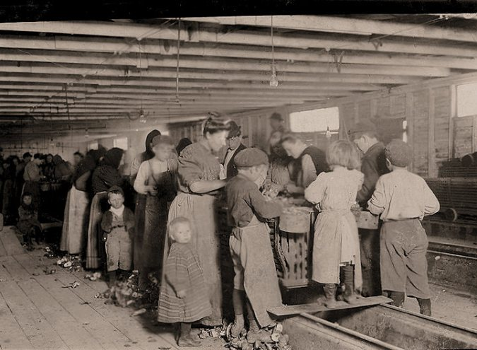 "I don't think I've ever seen a photograph of the ""Bohemian"" oyster shuckers that worked on the North Carolina coast in the late 19th and early 20th centuries. This photograph, however, depicts ""Bohemian"" shuckers in Louisiana in 1911. They could have worked on the NC coast as well: the Baltimore and New York City oyster companies often moved workers seasonally to different parts of the southern coast. Photo by Lewis Hine. Courtesy, the Library of Congress"