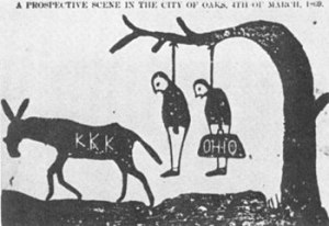 """Cartoon in an Alabama newspaper threatening scalawags (the victim on the left) and carpetbaggers (on the right). """"Scalawags"""" was a derogatory term for southern born whites that supported the Republican Party and Radical Reconstruction after the Civil War. Calvin Cox's enemies would have considered him a scalawag. From the <em>Independent Monitor</em> (Tuscaloosa, Ala.), Sept. 1868."""
