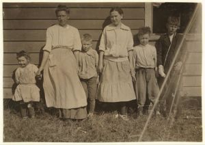 The Padgett family, Weldon, N.C. (Halifax County). Alfred, age 13, far right, and Richard, age 11, worked at the Shaw Cotton Mills. According to Lewis Hine, Alfred made $4.00 a week prior to a recent injury on the job (note his bandaged right hand). Richard made $2.40 a week. Photo by Lewis Hine. Courtesy, Library of Congress, Prints and Photographs Division