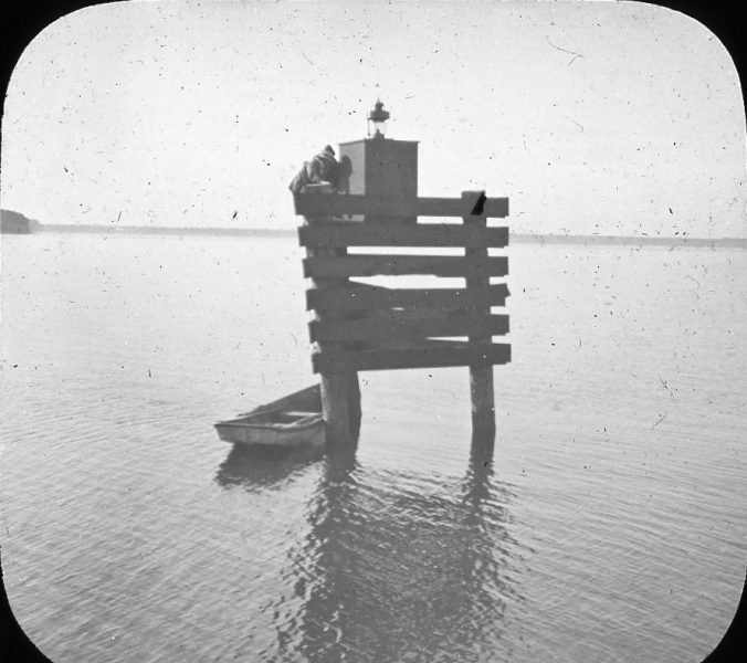 A lighted channel marker at an unknown locale in the U.S. Lighthouse Board's 5th District. Photo by Albert Ross, USN. Courtesy, Linda Garey