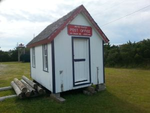 This 8 x 12 ft. post office served Salvo beginning about 1910, so it's not the one to which Capt. Bowser delivered mail in 1890. Nevertheless, it might give a sense of the kind of post office buildings common on Hatteras Island and other parts of the Outer Banks that time period. This was a movable building, and it would usually have been moved to the yard of whoever was the new postmaster or postmistress.