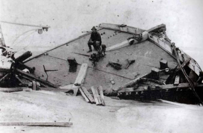 Surfman Rasmus Midgett on the wreckage of the Priscilla on Hatteras Island. The villages of Hatteras Island were also devastated in the 1899 storm, and more than 50 vessels were wrecked along the N.C. coast, including the 3-masted cargo ship Priscilla. Surfman Midgette was awarded the Life-Saving Service's highest honor for singlehandedly rescuing the 10-man crew while on patrol from the Gull-Shoals Life-Saving Station. Courtesy, State Archives of North Carolina