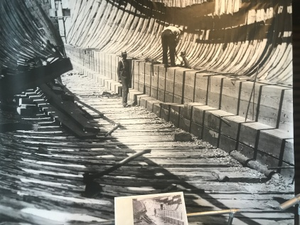 A wall of longleaf pine planking held together by forged iron drift bolts in the keelson of the 3-masted schooner Republic, Dunn & Elliot shipyard, Thomaston, Maine, 1900. Courtesy, Maine Maritime Museum