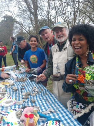 My awesome oyster shucking crew-- David, Zora, Tom, Bland and Michelle-- at a recent fundraiser that we held for the Stagville Historic Site. Photo by David Cecelski