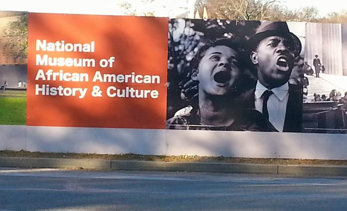 Museum billboard featuring Jacquelyn Bond (Shropshire) and Golden Frinks at the March on Washington in 1963.
