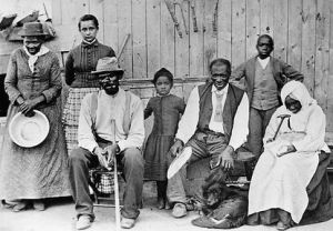Harriet Tubman, her adopted daughter Gertie Davis and her husband Nelson Davis, 1870s or '80s. Schomburg Center for Research in Black Culture, Photographs and Prints Division, New York Public Library.
