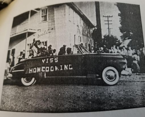 Miss Homecoming, Ms. Ovella Godette, and the Queen Street High School Homecoming Parade passing by the Godette Hotel in 1951. From the school's annual, The Seagull. Courtesy, Esther Anderson Williams and Ellen Williams Cavanaugh