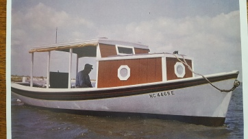Earl's uncle Joe Meekins (1892-1997) in his shad boat Foul Play, built by H. A. Creef, Sr. Meekins restored the boat and added the canopy to use it as a pleasure boat. Courtesy, Earl Willis, Jr.