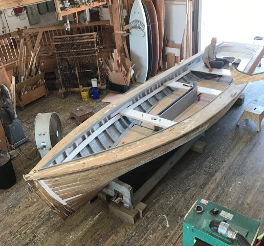 Overhead view of a curmudgeonly historian sitting in the shad boat Ella View at the N.C. Maritime Museum's boat shop in Beaufort, N.C. She was there for routine maintenance but is usually housed at the Roanoke Island Maritime Museum in Manteo, N.C. Photo by Tom Earnhardt