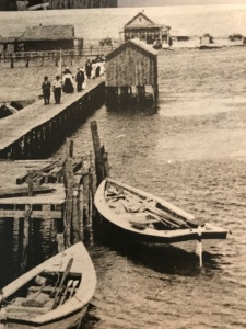 Shad boats tied up at sound side wharf, Old Nags Head, ca. 1900. Courtesy, State Archives of North Carolina