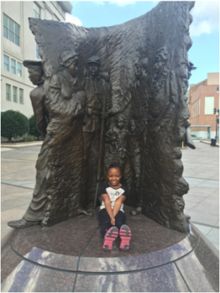 Marion's daughter Maya at the African American Civil War Memorial in Washington, DC. Photo by Marion Evans