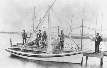 Fishermen posing with their shad boat and catch, Manteo, N.C., ca. 1900. Courtesy, State Archives of North Carolina