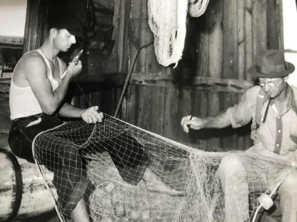 'm not sure, but I believe that this pair of fishermen are mending net at one of the mullet camps on Bald Head Island, ca. 1948-55. Photo by Bayard Wooten. Courtesy, N.C. Collection, UNC-Chapel Hill Library