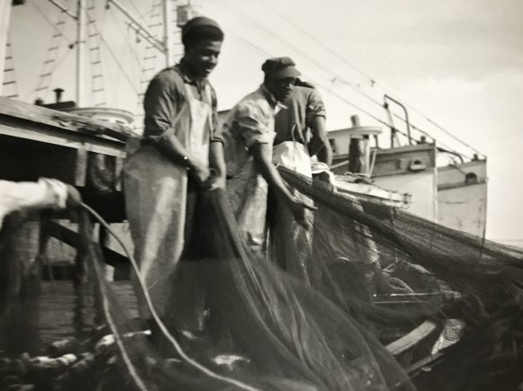 Menhaden fishermen gathering a purse seine at the dock, Southport, N.C., ca. 1948-55. Photo by Bayard Wooten. Courtesy, North Carolina Collection, UNC-Chapel Hill Library