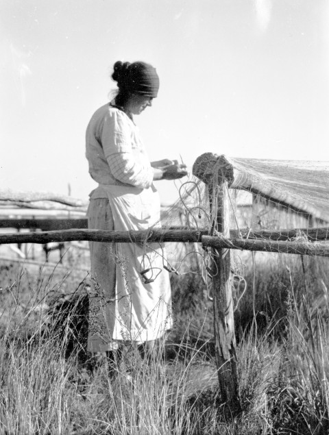 Woman mending probably a gill net, Sneads Ferry, N.C., ca. 1938. Photo by Charles A. Farrell. Courtesy, State Archives of North Carolina