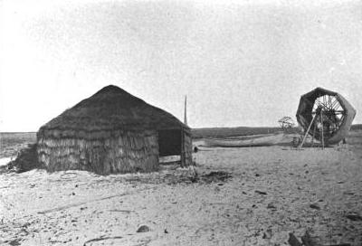 "A mullet fishermen's camp, Shackleford Banks, ca. 1907. The island was Charlie Willis's home when he was a boy. For generations, thatched roof huts like this, made of salt marsh grasses and bound by yucca threads, could be found along the island's shores. Crews of fishermen lived in them during the big fall runs of striped ""jumpin'"" mullet. From Hugh M. Smith, The Fishes of North Carolina"" (1907)."