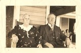 A later photograph of Capt. Charlie Willis and his wife, Elenous Guthrie Willis, on the front porch of their home at 1204 Shephard St. in the Promise Land, Morehead City, N.C. The couple raised 9 children there. Courtesy, the Promise Land Society