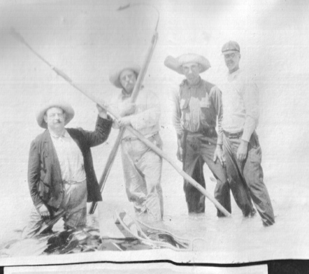 Russell Coles, Teddy Roosevelt and two of Coles' crewman from Morehead City, N.C.-- Roland Phillips and Mart Lewis. Near Punta Gorda, Fl., 1917. Courtesy, Walter Coles, Sr., Coles Hill, Va.
