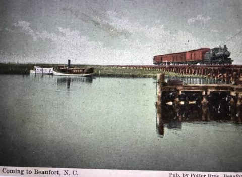 "Postcard view of the railroad to Morehead City on which Russell Coles traveled. This is on the causeway that was built over the marsh between Morehead City and Beaufort. For generations, locals called it the ""Old Mullet Road"" or the ""Old Mullet Line"" for the seemingly endless barrels of that salted fish with which they filled its freight cars. From Edward Ellis, ""Havelock Station Railroad History"" (remarks to Havelock Historical Preservation Society), July 27, 2004."