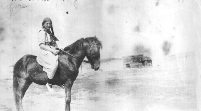 Theresa Ambler and one of the island's wild ponies, ca. 1921. Photo courtesy, Walter Coles, Sr., Chatham, Va.