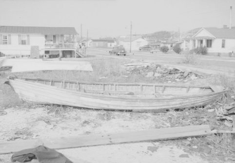 A later view of the edge of the Promise land in the 1940s. The boat in the foreground was said to be the last whaleboat used on the North Carolina coast. Its captain was John E. Lewis. Photo courtesy of the North Carolina Museum of History