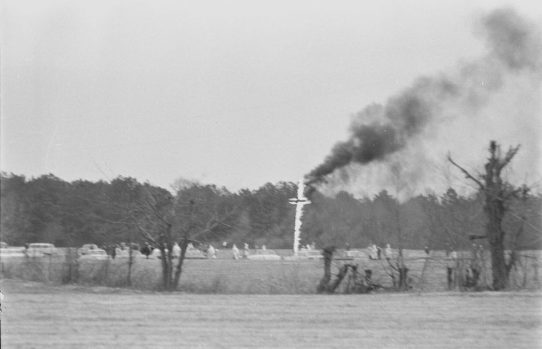 Klansmen burning a cross in the daylight in Pitt County, N.C., not far from Ernul, in March 1966, a month before the bombing of the Cool Springs FWB Church. From The Daily Reflector Photographic Files, ECU Digital Collections