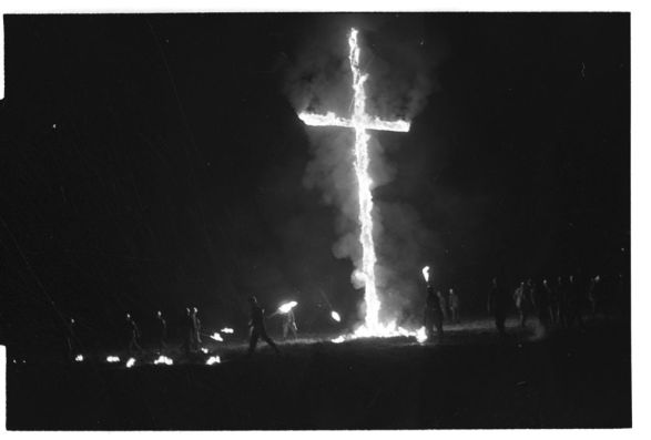 KKK members burning a cross in Greenville, N.C., 30 miles north of Ernul, Oct. 18-19, 1965. From the Daily Reflector Image Collection, ECU Digital Collections