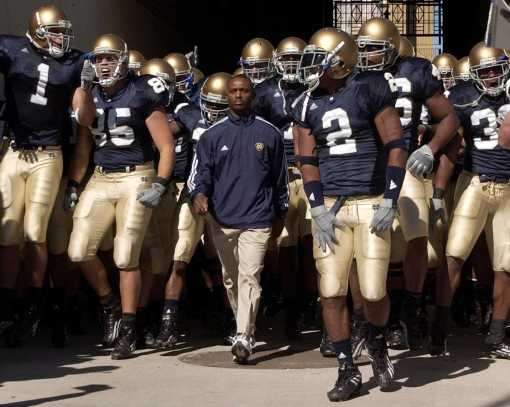 Coach Tyrone Willingham, shown here with his Notre Dame team in 2004, was a 5th grader in Jacksonville, N.C., when bombs destroyed the Georgetown High School in 1965. He often talks about the incident when he describes his youth and the adversities that he had to overcome. Photo by Sandra Dukes/Getty Images