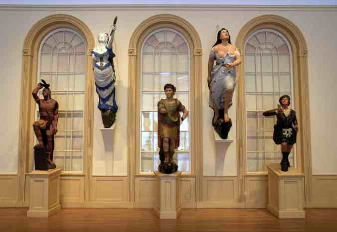 Collection of ship mastheads in the East India Marine Hall, Peabody Essex Museum, Salem, Mass. Courtesy, Peabody Essex Museum