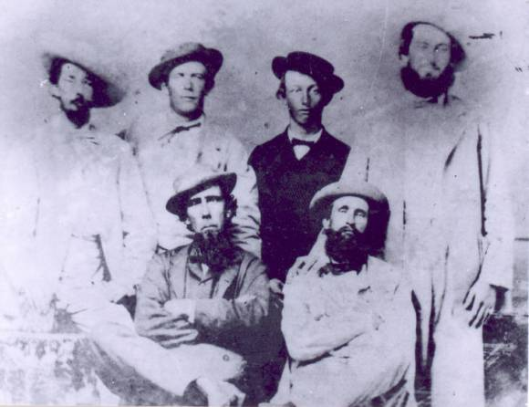 This jaunty group of Cape Fear River pilots includes men that were blockade runners during the Civil War. Thomas Newton (left) and Julius Dosher are sitting in the front, while Joseph Newton, an unknown young man, Joseph Bensel and Thomas Brinkman stand behind them. Courtesy, New Hanover Co. Public Library, NC Room. Identifier #00.037