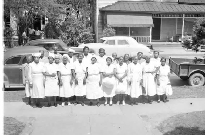 African American midwives in Greenville, 1951. According to a note in Joyner Library's files, Ms. Bessie Ward Harris (5th from left in the front row) was also a midwife and herbalist who was also well known for feeding the down and out out of her kitchen. Courtesy, Joyner Library, ECU